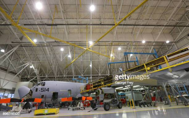 Aircraft mechanics work on a C130 cargo plane on December 20 2017 at Hill Air Force base in Ogden Utah Hill Air Force Base has one of the largest...