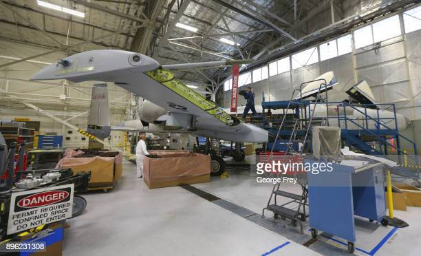 Aircraft mechanics work on an A10 Thunderbolt Warthog on December 20 2017 at Hill Air Force base in Ogden Utah Hill Air Force Base has one of the...