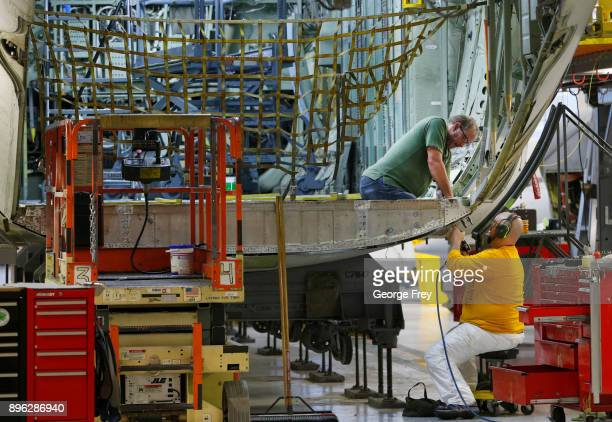Aircraft mechanics work on the lift gate on the tail section of a C130 cargo plane on December 20 2017 at Hill Air Force base in Ogden Utah Hill Air...