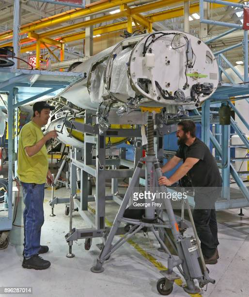 Aircraft mechanics work on the nose of an F16 Falcon on December 20 2017 at Hill Air Force base in Ogden Utah Hill Air Force Base has one of the...