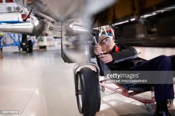 Aircraft mechnic in the hangar