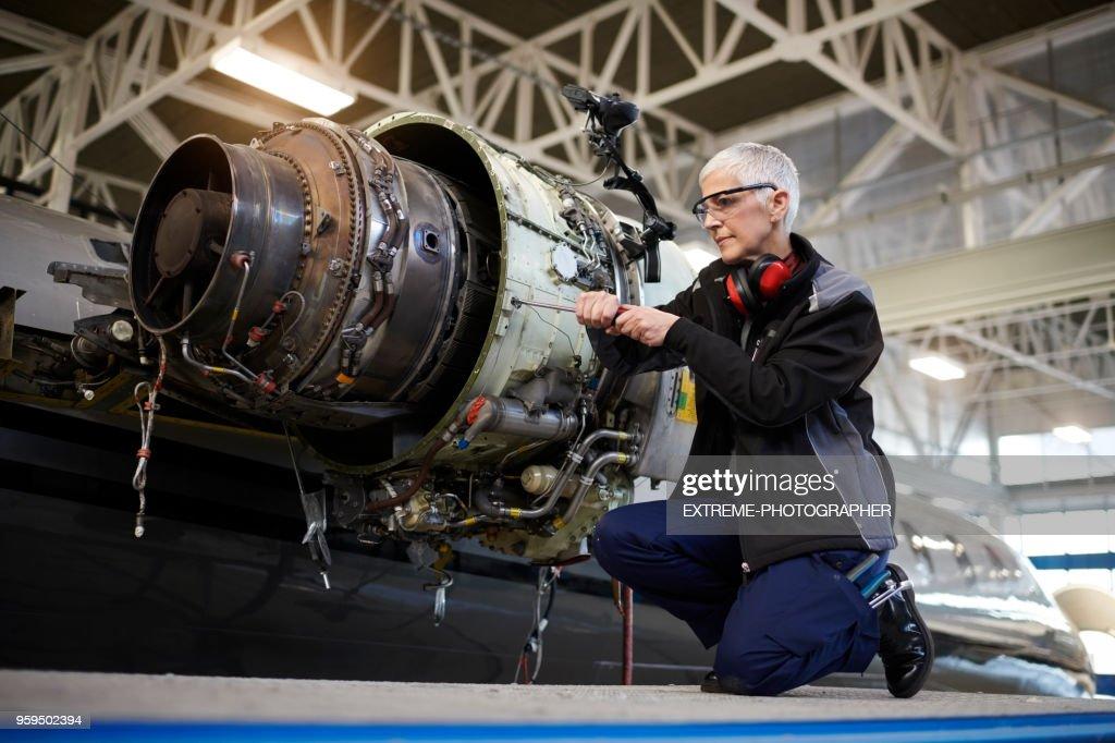 Aircraft mechnic in the hangar : Stock Photo
