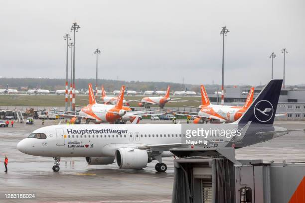 """Aircraft of airline Lufthansa arrives as first one at Berlin's airport """"Berlin Brandenburg Airport Willy Brandt"""", during the opening on the first day..."""