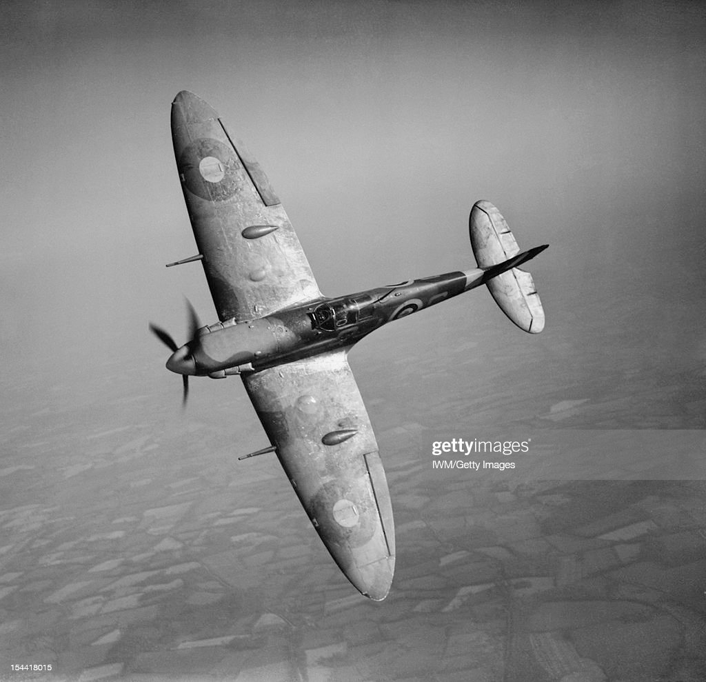 Aircraft Of The Royal Air Force, 1939-1945: Supermarine Spitfire, Spitfire Mark VB, R6923 'QJ-S', of No 92 Squadron RAF based at Biggin Hill, Kent, banking towards the photographing aircraft. R6923 was originally a Mark I, converted to a Mark V after serving with No. 19 Squadron and No. 7 Operational Training Unit in 1940. It was shot down over the sea by a Messerschmitt Bf 109 on 22 June 1941, 19 May 1941.