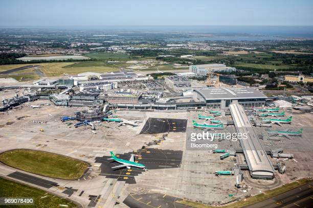 Aircraft operated by Aer Lingus Group Plc stand at gates at Dublin Airport Ireland on Wednesday June 6 2018 Companies are expanding in Dublin rather...