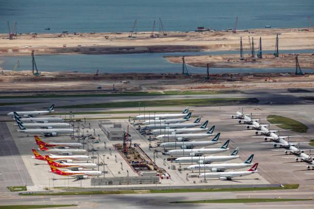 CHN: Cathay Pacific Aircraft at Hong Kong Airport Ahead of Earnings