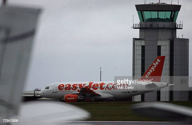 A aircraft operated by the budget airline EasyJet sits on the runway at Bristol International Airport January 7 2006 in Bristol England Thousands of...