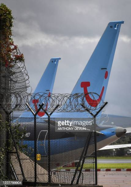 Aircraft operated by TUI are pictured at Manchester Airport in Manchester, north west England on July 27 following the holiday operator's decision to...