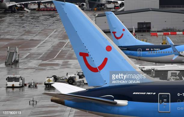 Aircraft operated by TUI are pictured at Manchester Airport in Manchester north west England on July 27 following the holiday operator's decision to...