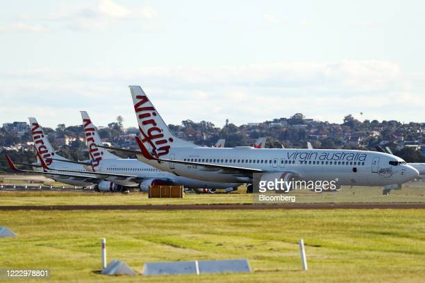 Aircraft operated by Virgin Australia Holdings Ltd. Stand on the tarmac at Sydney Airport in Sydney, Australia, on Friday, June 26, 2020.Bain...