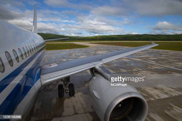 aircraft parked on the apron - fuselage stock photos and pictures