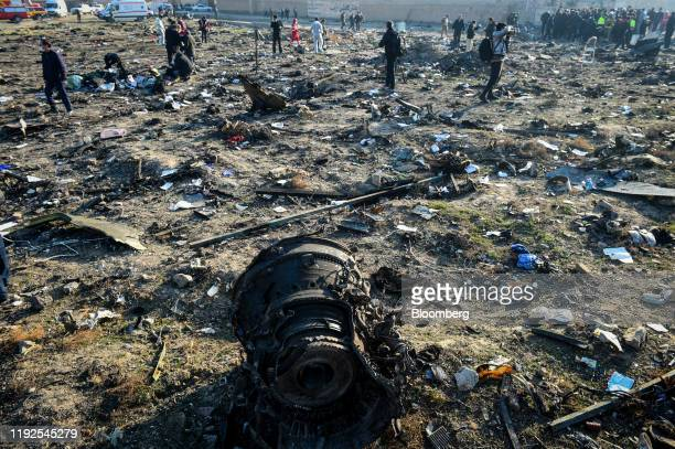 Aircraft parts from the wreckage of a Boeing Co 737800 aircraft operated by Ukraine International Airlines which crashed shortly after takeoff lie on...
