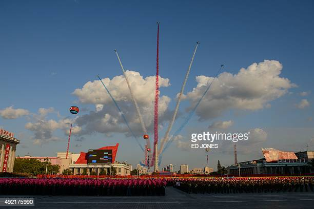 Aircraft perform a fly over past the Juche tower at Kim IlSung square in Pyongyang on October 10 2015 North Korea was marking the 70th anniversary of...
