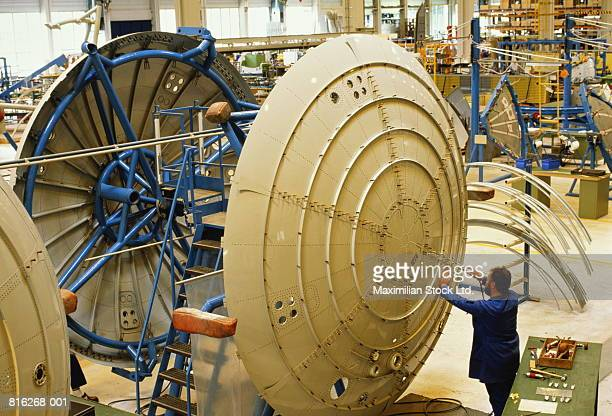 aircraft production, fuselage bulkhead pressure frame assembly - aircraft assembly plant stock pictures, royalty-free photos & images