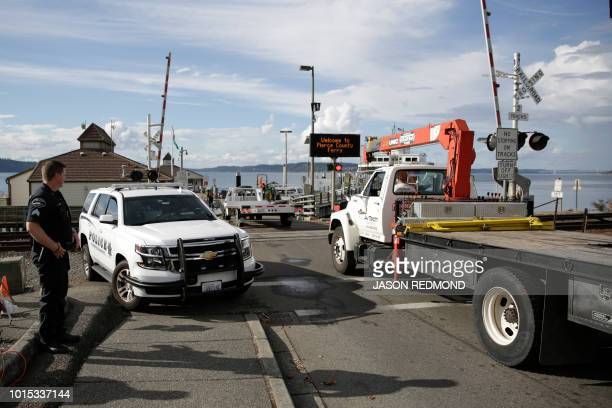 Aircraft retrieval vehicles arrive at the Steilacoom Ferry dock which takes investigators to Ketron Island the crash site of the Horizon Air...