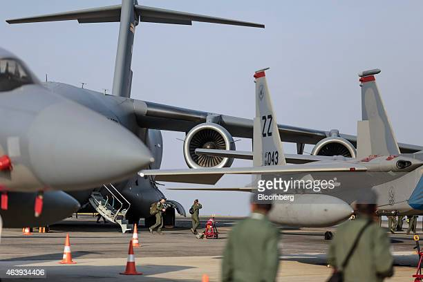 Aircraft sit on display during the Aero India air show at Air Force Station Yelahanka in Bengaluru India on Thursday Feb 19 2015 The biannual Aero...