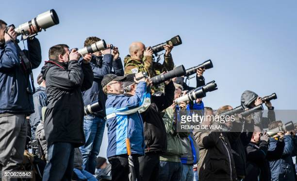 Aircraft spotters attend the international 'Frisian Flag 2016' exercise at Leeuwarden Airbase in The Netherlands on April 12 2016 Germany Finland...