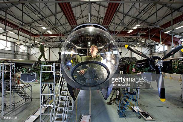 Aircraft technician Edward Cash works in the nose bay of a Lancaster Bomber at the 'Battle of Britain Memorial Flight' centre at RAF Coningsby on...