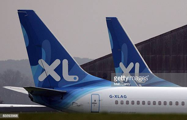 Aircraft that belonged to XL Airlines - which collapsed in September leaving 1000s of holiday makers stranded - sits awaiting its fate on the runway...