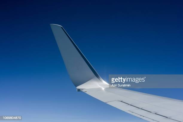 aircraft wing over sky - aircraft wing stock pictures, royalty-free photos & images
