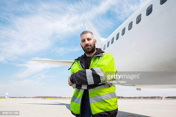Aircraft worker in front of airplane