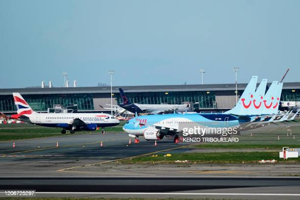 Aircrafts are parked at Brussels Airport, in Zaventem, outside Brussels, on March 12, 2020.