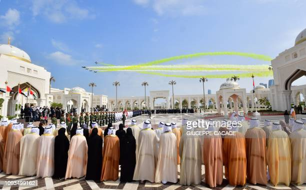 Aircrafts fly over the presidential palace in the UAE capital Abu Dhabi during a reception for Pope Francis on February 4, 2019. - Pope Francis...