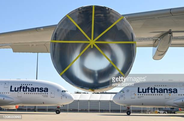 Aircrafts of German airline group Lufthansa are immobilised at the airport in Frankfurt, Germany, on March 23 as the group kept just a fraction of...