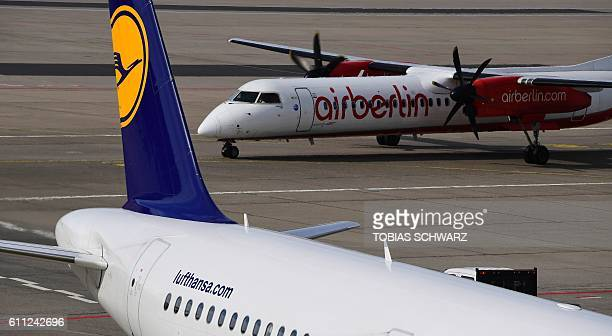 Aircrafts of German airlines Air Berlin and Lufthansa stand on the tarmac at the Tegel airport in Berlin on September 29 2016 Struggling Air Berlin...