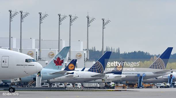 Aircraft's of several airline's sit on the tarmac of the FranzJosefStraussAirport in Munich southern Germany on April 27 2016 Walkouts by members of...