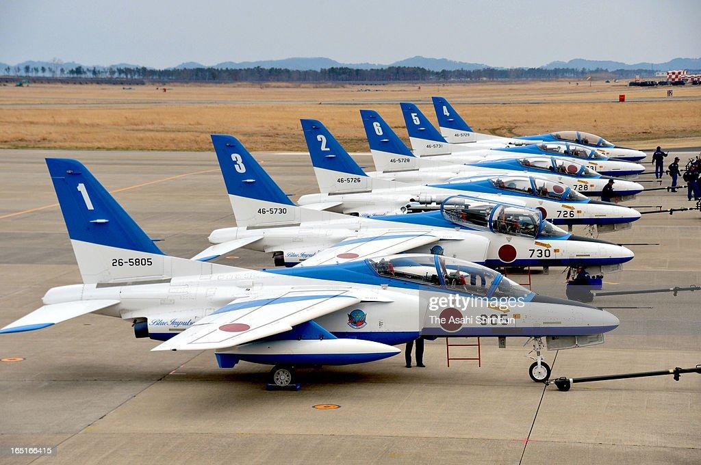 Aircrafts of the Japan Air Self-Defense Force's acrobatic flight team 'Blue Impulse' return to the Matsushima Air Base on March 31, 2013 in Higashimatsushima, Miyagi, Japan. The team had moved its base to the ASDFfs Ashiya Air Base in Fukuoka Prefecture after the Matsushima base was swamped by a tsunami on March 11, 2011.