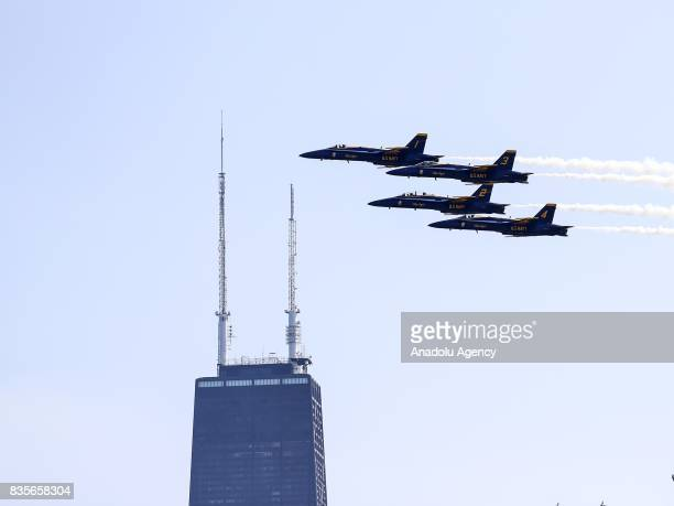 Aircrafts perform during the 59th Chicago Air and Water Show which is watched by about two million people at North Avenue Beach and around over Lake...