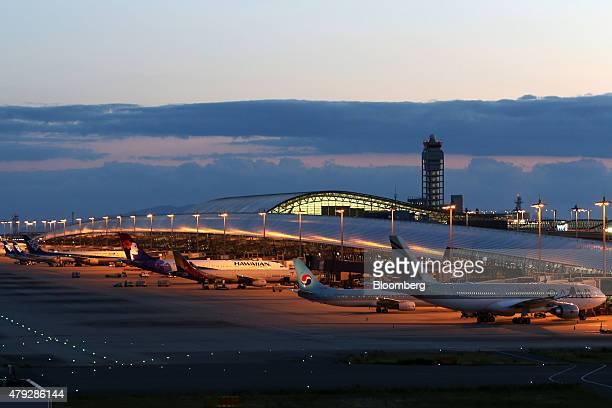 Aircrafts sit parked at dusk at the Kansai International Airport in Izumisano City Osaka Japan on Sunday June 28 2015 Staterun New Kansai...