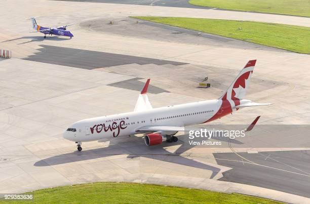 Aircrafts taxiing on airfield Manchester Airport Manchester United Kingdom Architect n/a 2015