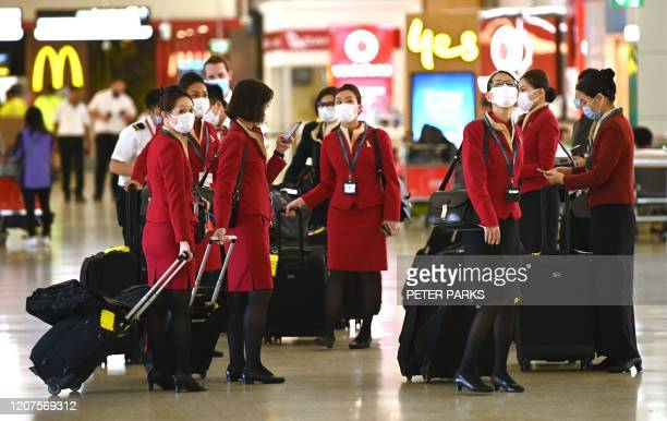 Aircrew arrive after landing at the international airport in Sydney on March 18, 2020. - Australia urged its citizens on March 18, not to travel...