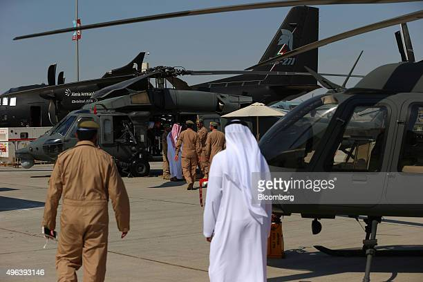 Aircrew lead visitors towards a Black Hawk UH60 military helicopter manufactured by Sikorsky Aircraft Corp for an inspection on the second day of the...