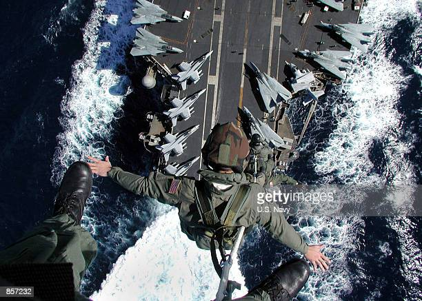 Aircrew members are lifted from the flight deck during Special Purpose Insertion/Extraction exercise February 26 2002 at sea aboard the USS John F...