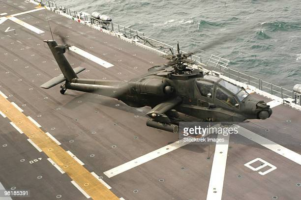 aircrew of an ah-64 apache helicopter conducting preflight checks before lifting off from the uss na - apache helicopter stock pictures, royalty-free photos & images