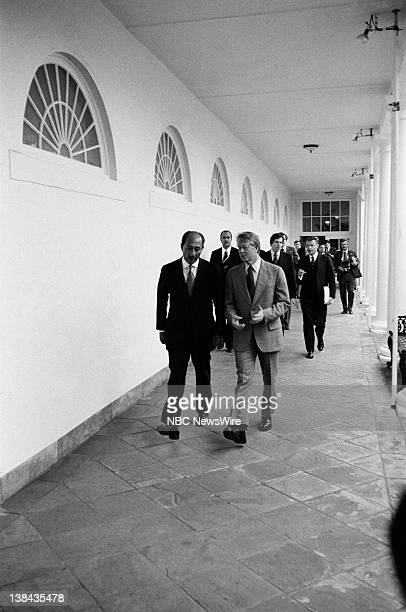 President of Egypt Anwar El Sadat US President Jimmy Carter walking on the colonnade of the White House on April 4 1977