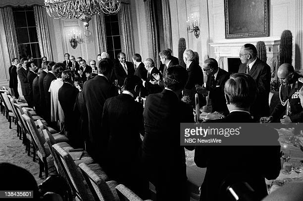 President of Egypt Anwar El Sadat US President Jimmy Carter during a dinner party in the State Dining Room on April 4 1977