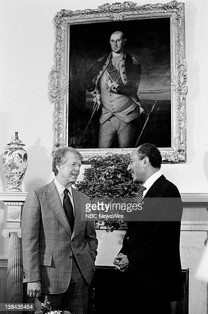 US President Jimmy Carter and President of Egypt Anwar El Sadat during a press photo opportunity in the Oval Office of the White House on April 4 1977