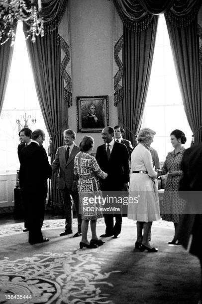 US President Jimmy Carter President of Egypt Anwar El Sadat First Lady of Egypt Jehan Al Sadat greeting guests attending a tea hosted by US First...