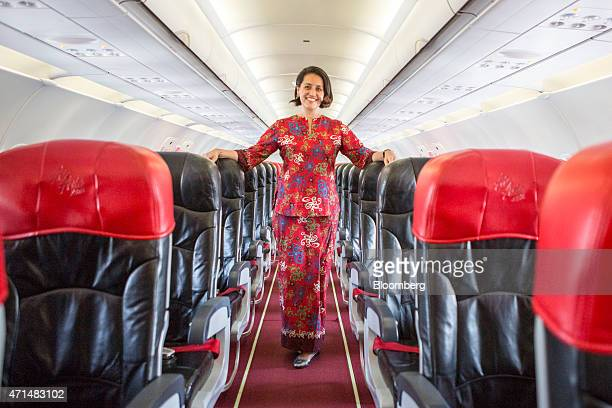 Aireen Omar chief executive officer of AirAsia Bhd stands for a photograph inside one of the airline's Airbus Group NV A320 aircraft at the Langakawi...