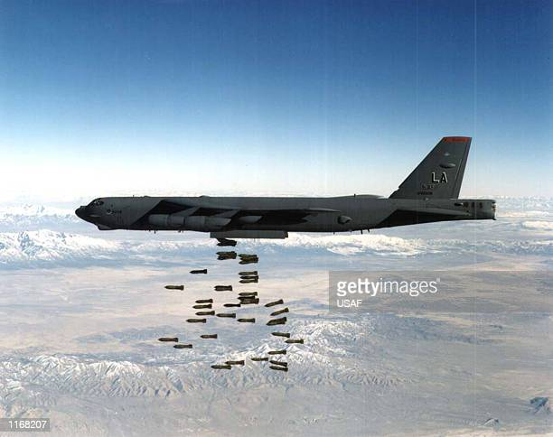 Airforce B-52 Stratofortress heavy bomber drops bombs in this undated file photo. The United States and Britain launched powerful air and missile...