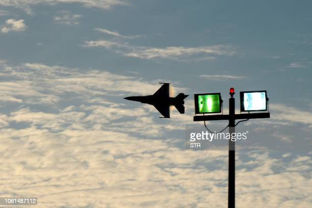 Airforce F-16 multirole fighter performs air maneuvers during the 2018 Bahrain International Airshow at the Sakhir Airbase, south of the Bahraini...