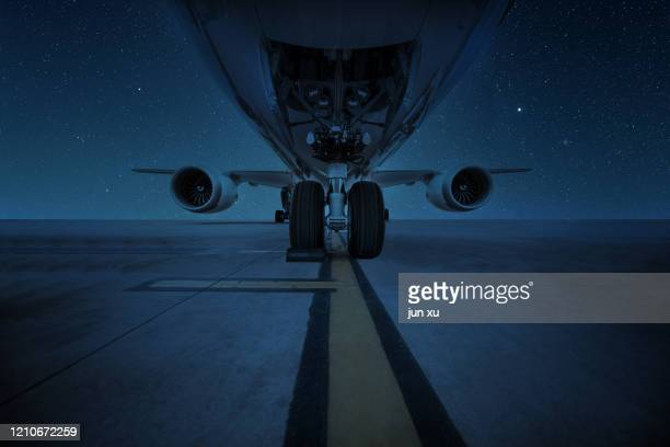 airframes and turbines under the stars - taxiway stock pictures, royalty-free photos & images