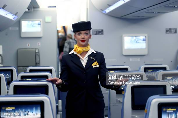 A airhostess of German airline Lufthansa stands in cabine at the passenger deck of the company's first Airbus A350900 passenger plane during a...