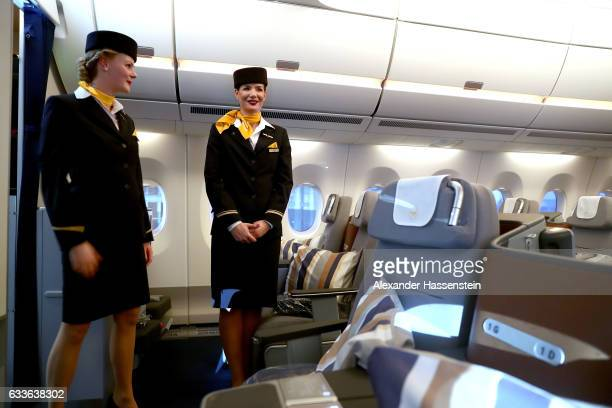 Airhostesses of German airline Lufthansa stand in cabine at the passenger deck of the company's first Airbus A350900 passenger plane during a rollout...