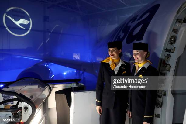 Airhostesses of German airline Lufthansa stands a the main door of Lufthansa's first Airbus A350900 passenger plane during a rollout event at Munich...