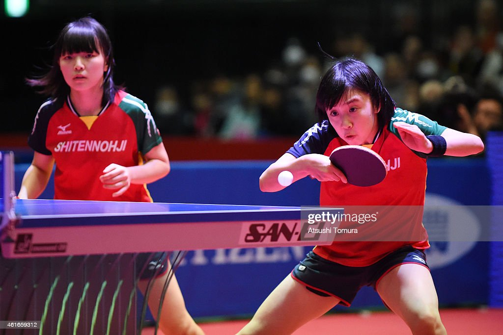 Airi Abe (L) and Mizuki Morizono (R) of Japan competes in the Women's doubles final match against Sayaka Hirano and Kasumi Ishikawa of Japan during day six of All Japan Table Tennis Championships 2015 at Tokyo Metropolitan Gymnasium on January 17, 2015 in Tokyo, Japan.